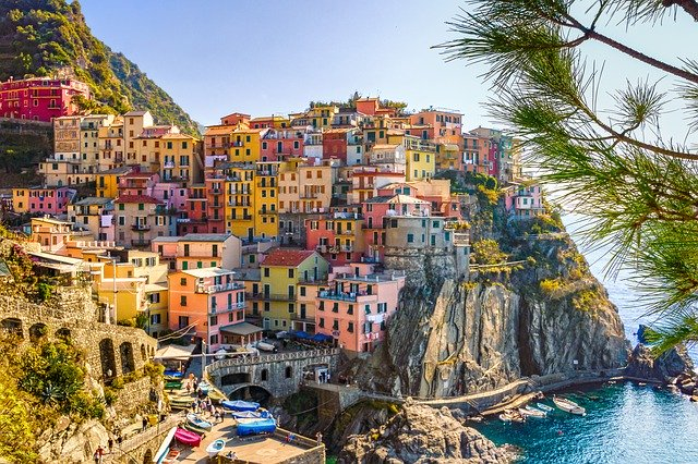 Colorful Italian Coastal Homes on a Cliff; image by A Difference of Opinion is not an Argument... Unless We Make it One. He likes green, she prefers gold. She loves coffee, he prefers tea. She likes Prius, he loves his truck. He's fond of sports, she'd rather read. All of these are just a difference of opinion and preferences. None are a reason for dislike. And yet many arguments start there... at differences that are seemingly irreconcilable. The Same Thing - Different Names Researchers, psychologists, philosophers, spiritual leaders and anthropologists have all discovered that all humans have the same basic wants and needs. Beyond survival, we all have the same basic need to love and be loved. A difference of opinion is often a matter of conditioning, indoctrination, and exposure to certain culture. Often, differences are simply preferences. What if we leaned into eagerly learning another's perspective, especially when different from ours? Contrasts Art is about about contrasts and the play of color, shadow and light, and it's the same for life. It is the dark that is the backdrop for the stars. The struggles that make us strong for victory, the despair that makes the joys ever so precious... the storms that remind us of the glory of the sun. Differences paint color on the canvas of life. Play with differences of opinion the way you'd play with colors.~LeAura Alderson, cofounder iCreateDaily.com® Open to Adventure Most people like to travel. What travel does for us is engage our sense of adventure and childlike inquiry as we engage in the discovery of new places, people, and experiences. When we travel and engage new experiences, those are external to us though we then internalize the experiences and hold them as memories. What if we viewed a difference of opinion as an opportunity to travel to a new place within..? To a new place of mind, of thinking.. and way of seeing?