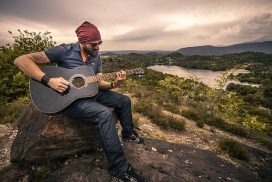 Guitarist in nature; Create More, Consume Less, Creation Vs Consumption, Creativity Brings Happiness