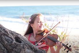 Karolina Protsenko-child violinist playing Moana cover at the beach-image via YouTube