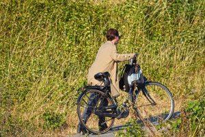 You CAN do hard things. Woman pushing bike uphill. #DoHardThings #YouCanDoHardThings #Effort #iCreateDailly